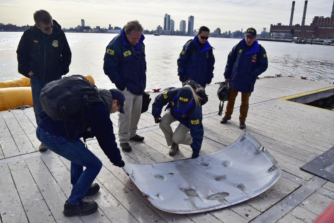<p>In this photo provided by the National Transportation Safety Board (NTSB) investigators examine part of a helicopter, March 12, 2018, that crashed into New York's East River on Sunday evening. (Photo: NTSB via AP) </p>