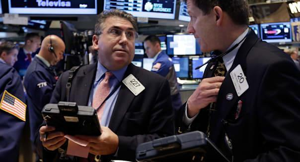 Wall Street (Trader John Bishop, left, and CHristopher Forbes work on the floor of the New York Stock Exchange Tuesday, Oct. 22,