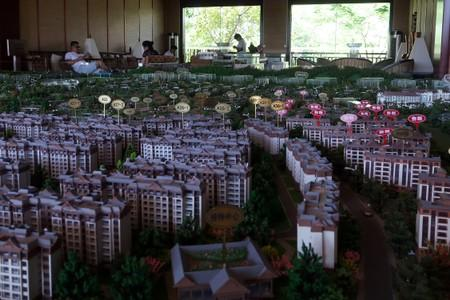 "Model showing property project ""Yulinyuanzhu"" developed by Shanghai Red Star Macalline Real Estate Group is seen at a showroom in Xishuangbanna, Yunnan"