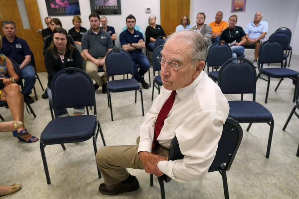 In this June 30, 2021, photo Sen. Chuck Grassley, R-Iowa, listens to a question during a meeting with employees at Professional Computer Solutions in Denison, Iowa. (AP Photo/Charlie Neibergall)