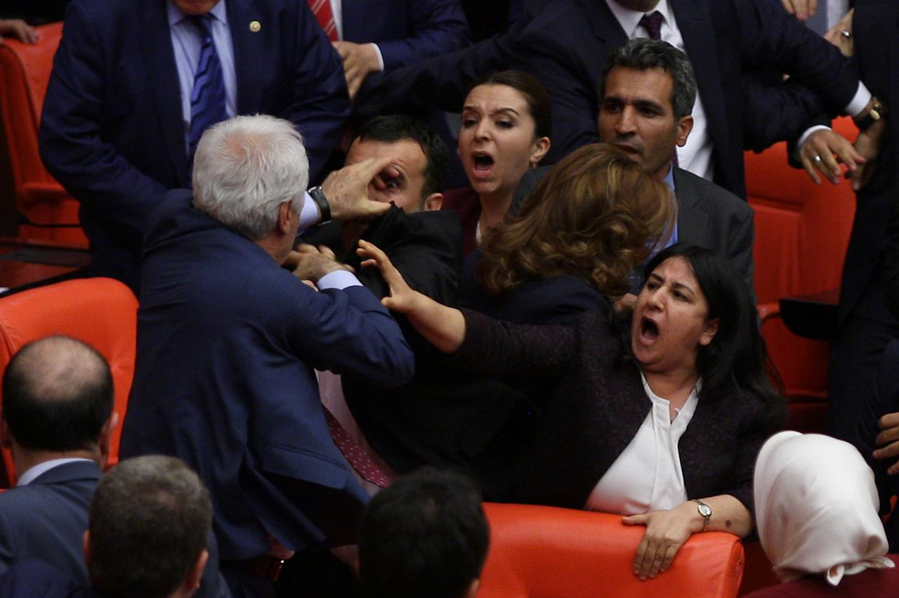 Ruling AK Party and pro-Kurdish Peoples' Democratic Party (HDP) lawmakers scuffle during a debate at the Parliament in Ankara, Turkey late April 27, 2016.    REUTERS/Stringer   EDITORIAL USE ONLY. NO RESALES. NO ARCHIVE     TPX IMAGES OF THE DAY