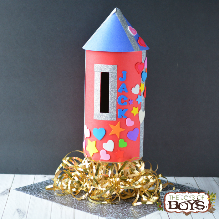 "<p>Any space-obsessed child will be obsessed with this colorful rocket ship that's ready to blast off to the moon.</p><p><strong>Get the tutorial at <a href=""https://thejoysofboys.com/rocket-valentine-box/"" rel=""nofollow noopener"" target=""_blank"" data-ylk=""slk:The Joys of Boys"" class=""link rapid-noclick-resp"">The Joys of Boys</a>.</strong></p><p><strong><a class=""link rapid-noclick-resp"" href=""https://www.amazon.com/Duck-Glitter-Crafting-1-88-Inch-5-Yard/dp/B00GO4Y6JC/ref=sr_1_1?tag=syn-yahoo-20&ascsubtag=%5Bartid%7C10050.g.25844424%5Bsrc%7Cyahoo-us"" rel=""nofollow noopener"" target=""_blank"" data-ylk=""slk:SHOP GLITTER TAPE"">SHOP GLITTER TAPE</a><br></strong></p>"