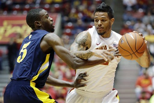 Iowa State guard Chris Babb, right, drives past North Carolina A&T guard Jean Louisme during the first half of an NCAA college basketball game, Tuesday, Nov. 20, 2012, in Ames, Iowa. (AP Photo/Charlie Neibergall)
