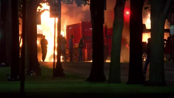 Protesters set vehicles on fire in Kenosha