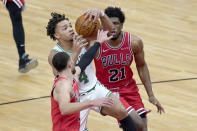 Chicago Bulls' Zach LaVine, left, strips the ball from Boston Celtics' Carsen Edwards (4) as Bulls' Thaddeus Young watches during the first half of an NBA basketball game Monday, Jan. 25, 2021, in Chicago. (AP Photo/Charles Rex Arbogast)