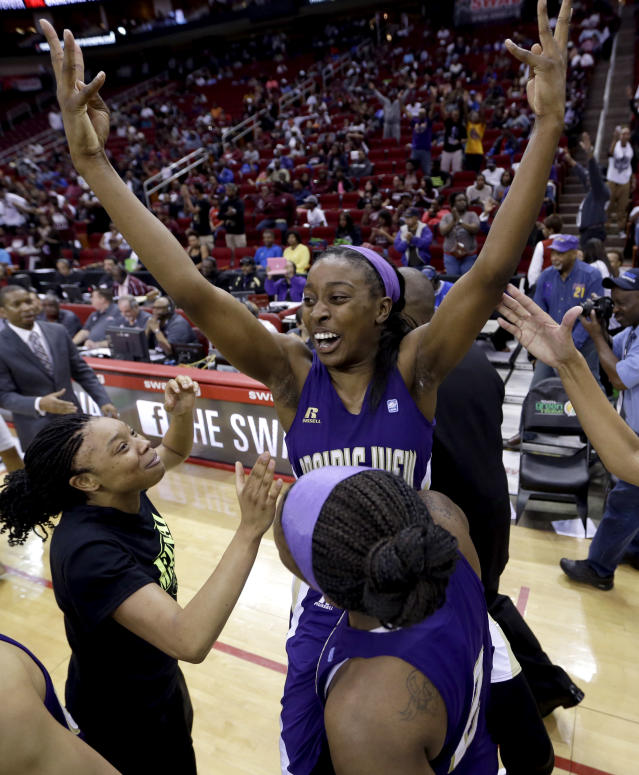Prairie View A&M's LaReahn Washington, rear, celebrates as she is lifted up by Shamiya Brooks after their team beat Texas Southern 63-58 in an NCAA college basketball game in the championship of the Southwestern Athletic Conference tournament Saturday, March 15, 2014, in Houston. (AP Photo/David J. Phillip)