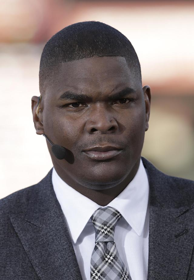 Former NFL receiver and television analyst Keyshawn Johnson is seen before an NFL football game between the San Francisco 49ers and the Atlanta Falcons in San Francisco, Monday, Dec. 23, 2013. (AP Photo/Tony Avelar)