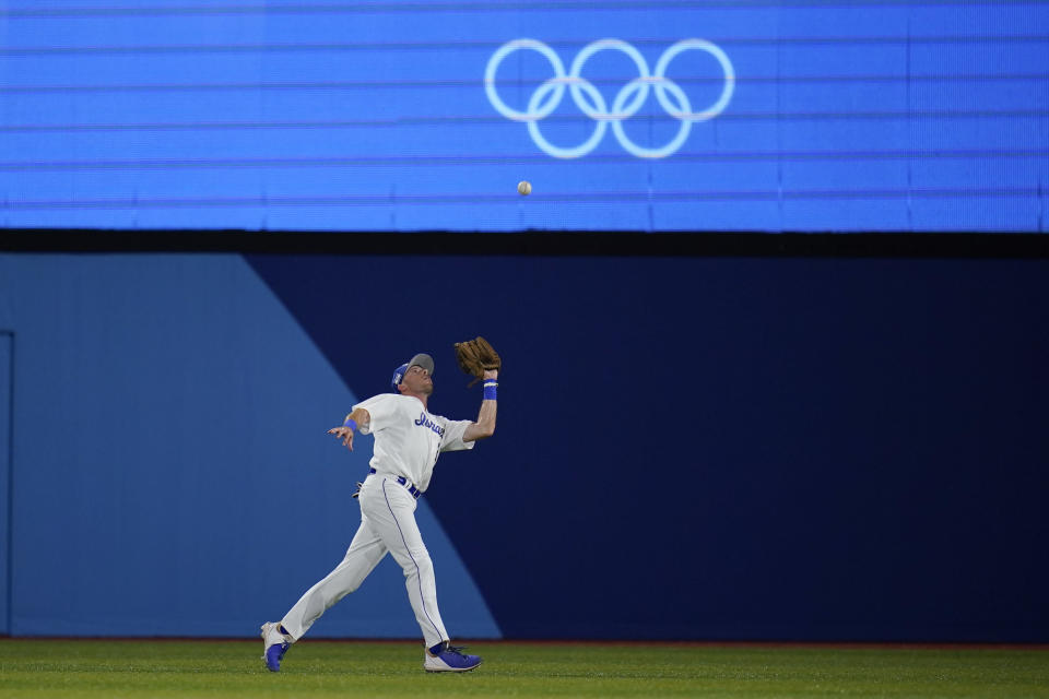 Israel's Mitchell Glasser catches a fly out hit by United States' Jamie Westbrook in the fifth inning of a baseball game at the 2020 Summer Olympics, Friday, July 30, 2021, in Yokohama, Japan. (AP Photo/Sue Ogrocki)