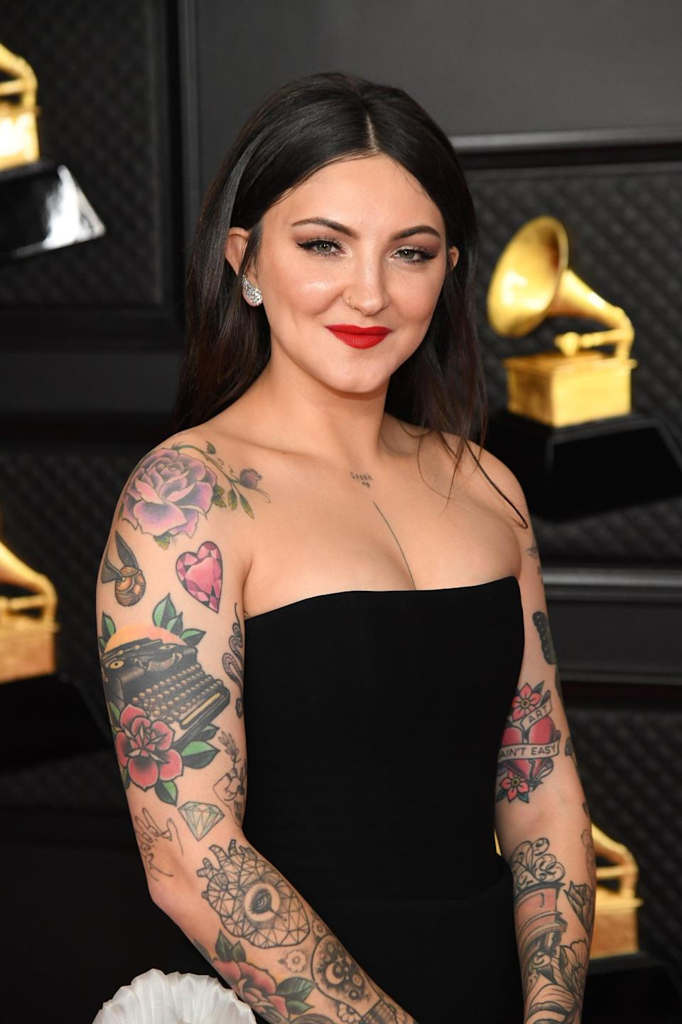 """<p>Scattered throughout Michaels's arms are four gemstone tattoos, with the most visible one being the heart-shaped pink stone on her right shoulder. They are for her fans, who she calls her """"little gems."""" She got them in July of 2018.</p>"""