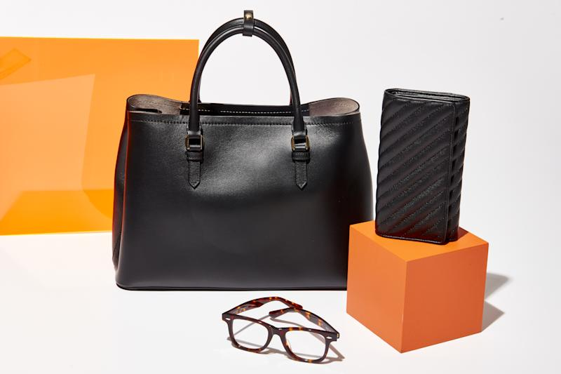 Products from Italic's selection, including a tote bag ($250), continental wallet ($75), and glasses ($75), from the same factories used by luxury brands