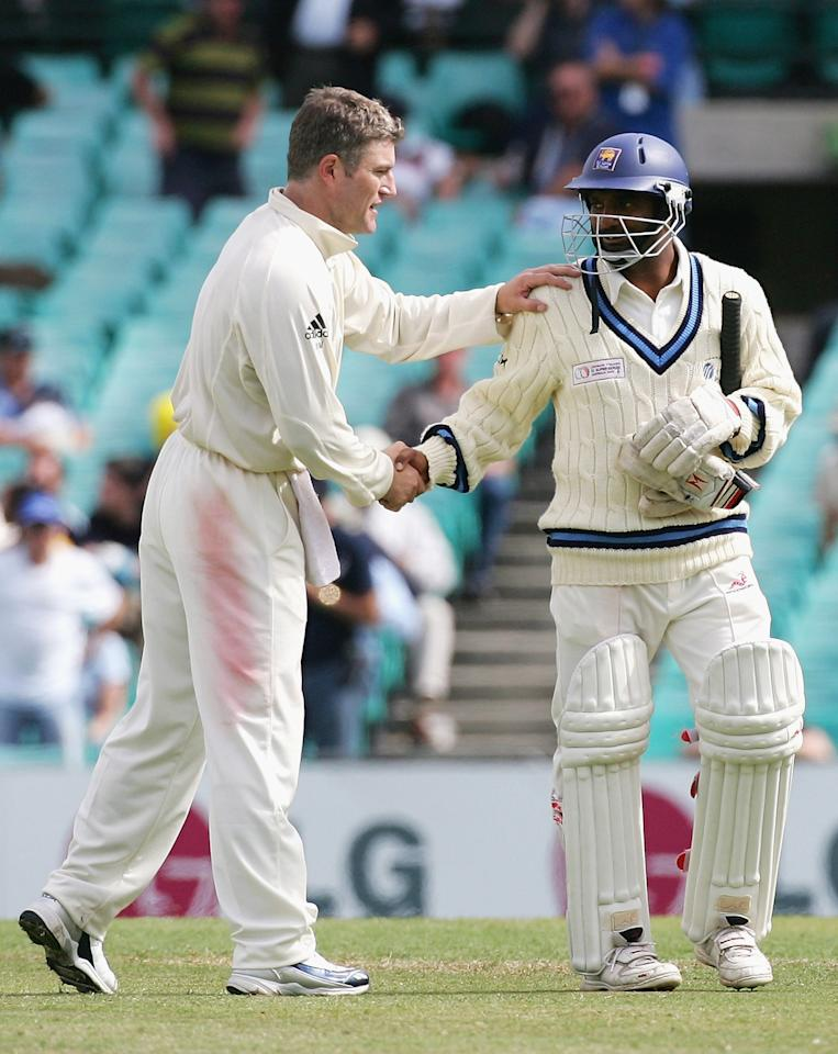 SYDNEY, NSW - OCTOBER 17:  (L-R) Stuart MacGill of Australia shakes hands with Muttiah Muralitharan of the ICC World XI at the end of the game as Australia win the Test by 210 runs on day four of the Johnnie Walker Super Series Test between Australia and the ICC World XI played at the Sydney Cricket Ground on October 17, 2005 in Sydney, Australia.  (Photo by Hamish Blair/Getty Images)