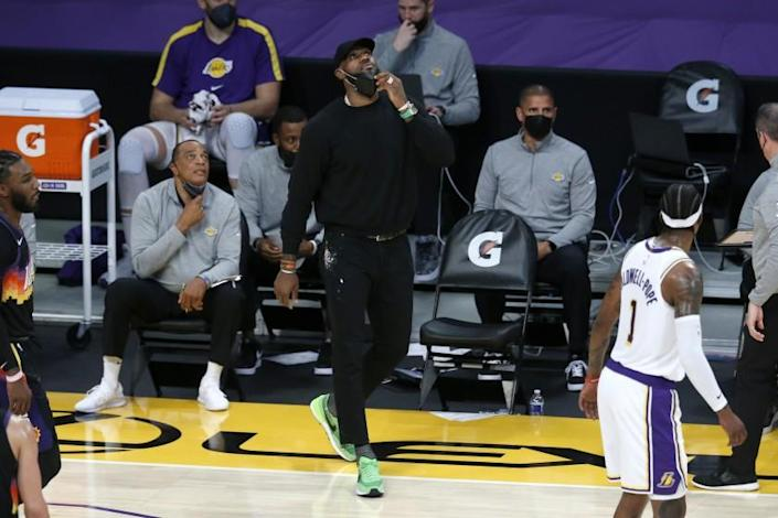LOS ANGELES, CA - MAY 09: Los Angeles Lakers forward LeBron James (23) watched from the sideline in a game against the Phoenix Suns in the first quarter at the Staples Center on Sunday, May 9, 2021 in Los Angeles, CA. (Gary Coronado / Los Angeles Times)