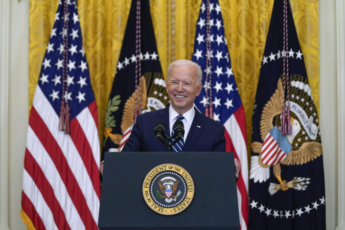 President Joe Biden smiles as he speaks during a news conference in the East Room of the White House, Thursday, March 25, 2021, in Washington. (Evan Vucci/AP Photo)