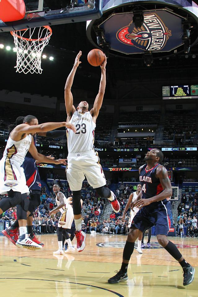 NEW ORLEANS, LA - FEBRUARY 5: Anthoy Davis #23 of the New Orleans Pelicans grabs a rebound against a rebound during a game against the Atlanta Hawks on February 5, 2014 at the New Orleans Arena in New Orleans, Louisiana. (Photo by Layne Murdoch Jr./NBAE via Getty Images)