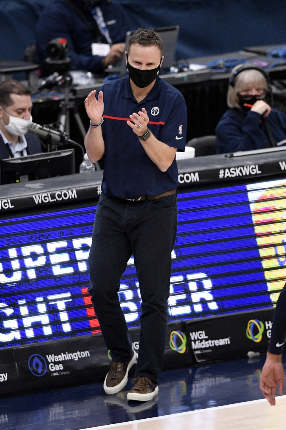 Washington Wizards head coach Scott Brooks reacts during the second half of an NBA basketball game against the Miami Heat, Saturday, Jan. 9, 2021, in Washington. (AP Photo/Nick Wass)