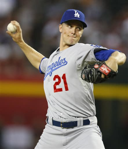 Los Angeles Dodgers starting pitcher Zack Greinke (21) throws against the Arizona Diamondbacks in the first inning during a baseball game on Monday, July 8, 2013, in Phoenix. (AP Photo/Rick Scuteri)