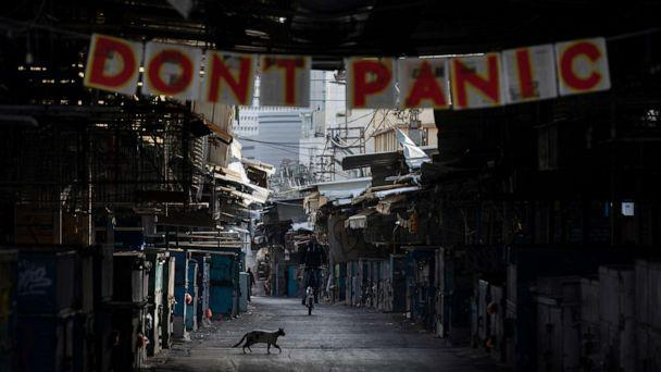 PHOTO: A 'don't panic' sign hang on the entrance of a closed food market that was shut down in order to reduce the spread of the coronavirus, in Tel Aviv, Israel, March 23, 2020. (Oded Balilty/AP)