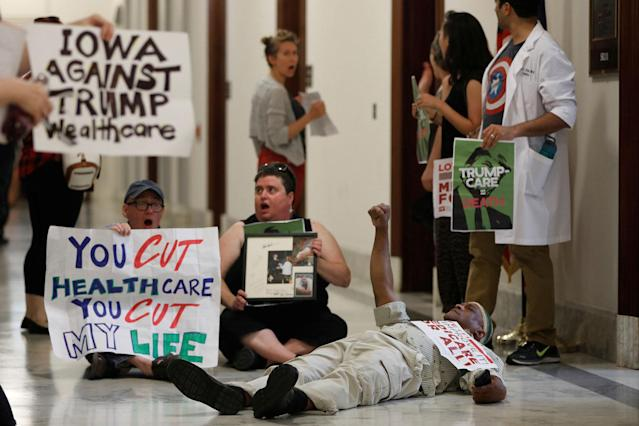 <p>Healthcare activists are detained by Capitol Police after gathering to protest the Republican healthcare bill on Capitol Hill in Washington, July 19, 2017.(Photo: Aaron P. Bernstein/Reuters) </p>