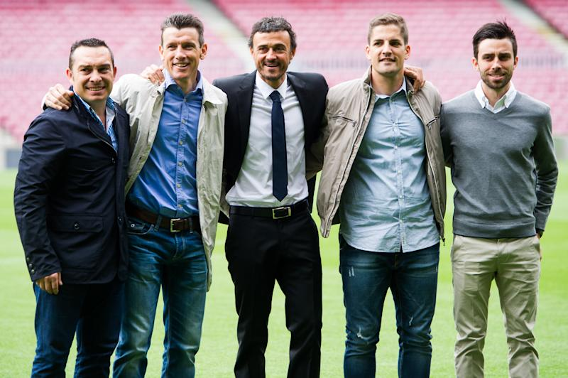 BARCELONA, SPAIN - MAY 21: Luis Enrique Martinez (C) poses for the media with members of his staff (L-R) Joaquin Valdes, Juan Carlos Unzue, Robert Moreno and Rafael Pol during his official presentation as the new coach of FC Barcelona at Camp Nou on May 21, 2014 in Barcelona, Spain. (Photo by Alex Caparros/Getty Images)