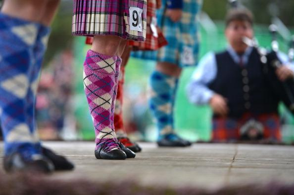 Highland dancer compete at the Braemar Highland Games at The Princess Royal and Duke of Fife Memorial Park on September 1, 2012 in Braemar, Scotland. The Braemar Gathering is the most famous of the Highland Games and is known worldwide. Each year thousands of visitors descend on this small Scottish village on the first Saturday in September to watch one of the more colorful Scottish traditions. The Gathering has a long history and in its modern form it stretches back nearly 200 years. (Photo by Jeff J Mitchell/Getty Images)