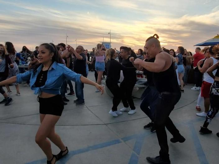Approaching a new dance floor is always intimidating. Here, Angelenos dance to salsa and bachata near the Venice Pier as Covid-19 figures continue to drop and restrictions ease.