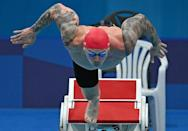 Reigning champion Adam Peaty of Britain looked powerful in his 100m breaststroke heat