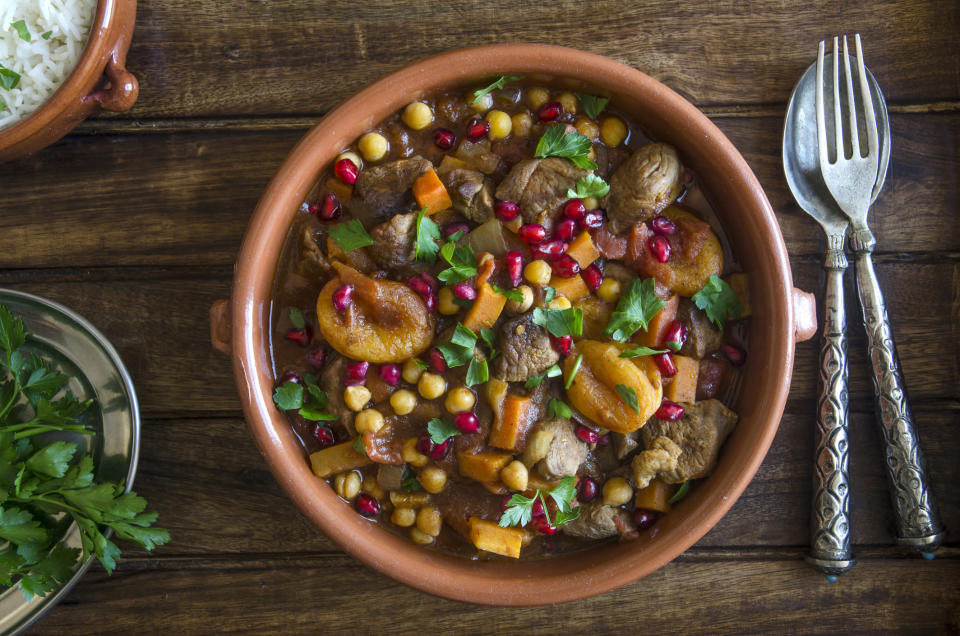 """<p>For a slightly eastern twist on a winter warmer, how about a tagine? <a rel=""""nofollow noopener"""" href=""""https://www.rivercottage.net/recipes/lamb-and-apricot-tagine"""" target=""""_blank"""" data-ylk=""""slk:River Cottage's recipe"""" class=""""link rapid-noclick-resp"""">River Cottage's recipe</a> adds apricots for that trademark fruity flavour. [Photo: Getty] </p>"""