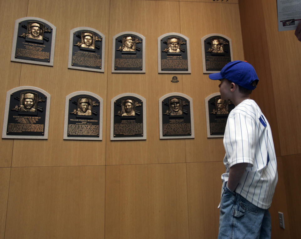 A young fan visits the plaque room at the National Baseball Hall of Fame in Cooperstown.