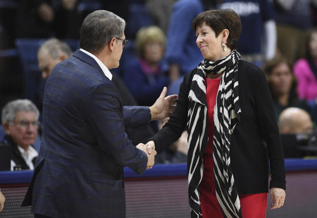 Notre Dame head coach Muffet McGraw, right, shakes hands with Connecticut head coach Geno Auriemma at the end of an NCAA college basketball game, Sunday, Dec. 8, 2019, in Storrs, Conn. (AP Photo/Jessica Hill)