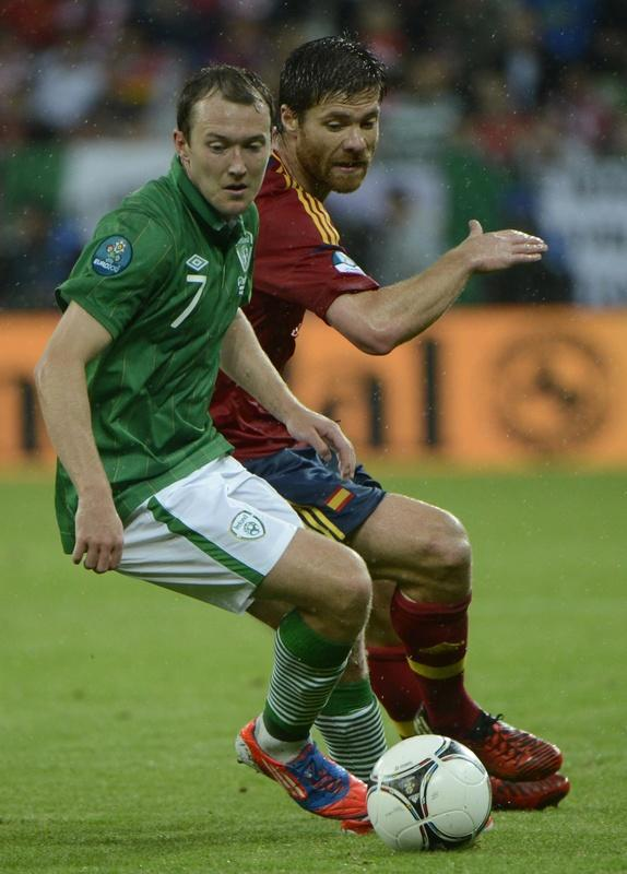 Spanish midfielder Xabi Alonso (R) vies with Irish midfielder Aiden McGeady during the Euro 2012 championships football match Spain vs Republic of Ireland on June 14, 2012 at the Gdansk Arena. AFP PHOTO / PIERRE-PHILIPPE MARCOUPIERRE-PHILIPPE MARCOU/AFP/GettyImages