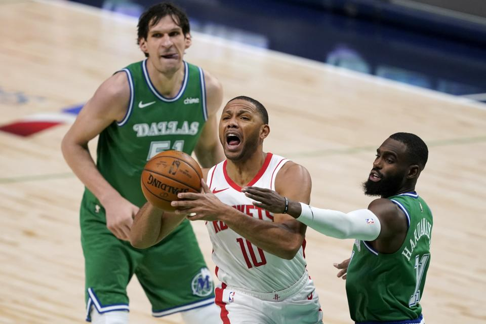Houston Rockets guard Eric Gordon (10) is defended by Dallas Mavericks' Boban Marjanovic (51) and Tim Hardaway Jr. (11) during the second half of an NBA basketball game in Dallas, Saturday, Jan. 23, 2021. (AP Photo/Tony Gutierrez)