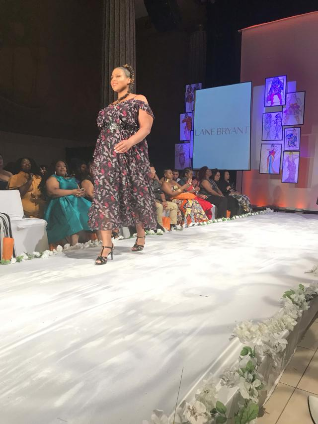 A model wears a floral off-the-shoulder dress by Lane Bryant at Full Figured Fashion Week's finale in New York City. (Photo: Courtesy of Lane Bryant/Cacique)
