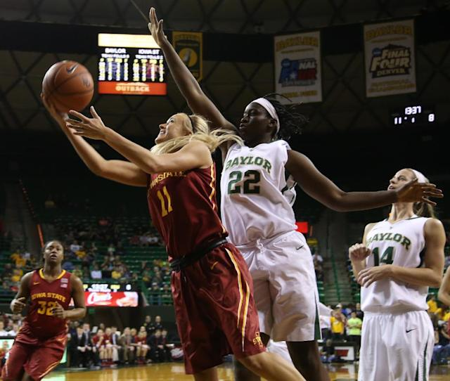 Iowa State guard Jadda Buckley (11), left, drives past Baylor forward/center Sune Agbuke (22), right, in the first half of an NCAA college basketball game, Wednesday, Feb. 19, 2014, in Waco, Texas. (AP Photo/Rod Aydelotte)
