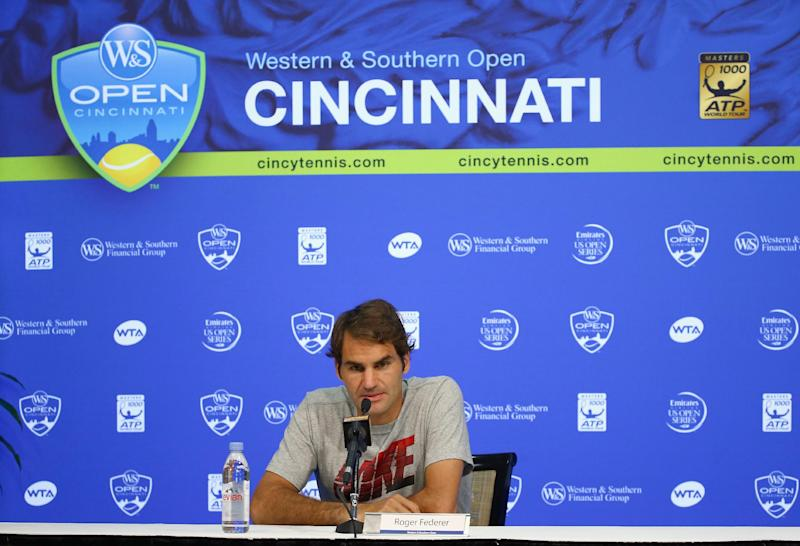 Roger Federer of Switzerland talks to the media at the Western & Southern Open at the Lender Family Tennis Center on August 12, 2014 in Cincinnati, Ohio