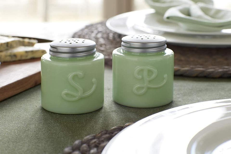 """<p>Everyone needs a set of fancy salt-and-pepper shakers and a set of fun ones, and this jadeite duo is bound to bring a touch of happiness to any table.</p> <p><strong>Buy It: $34.95; <a href=""""https://www.amazon.com/KitchenCraft-KCSNPGLSGRN-Glass-Pepper-Shakers/dp/B07SVH16FC/ref=as_li_ss_tl?ie=UTF8&linkCode=ll1&tag=slhomejadeitekitchentrendkyarborough0820-20&linkId=25fa3283a49df1ffd87c06c9070d281e&language=en_US"""" rel=""""nofollow noopener"""" target=""""_blank"""" data-ylk=""""slk:amazon.com"""" class=""""link rapid-noclick-resp"""">amazon.com</a></strong></p>"""