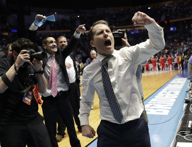 Nevada head coach Eric Musselman celebrates as his team defeated Cincinnati during a second-round game in the NCAA college basketball tournament in Nashville, Tenn., Sunday, March 18, 2018. Nevada defeated Cincinnati 75-73. (AP Photo/Mark Humphrey)