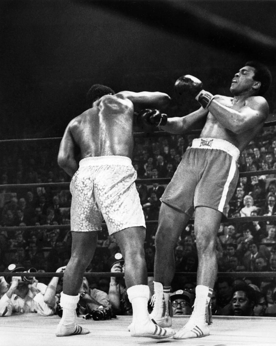 """<p>American heavyweight boxing champion Joe Frazier (L) kept his title at the end of the fight called the """"match of the century"""" against his compatriot Muhammad Ali at the Madison Square Garden, in New York, March 08 1971. (AFP/Getty Images)</p>"""