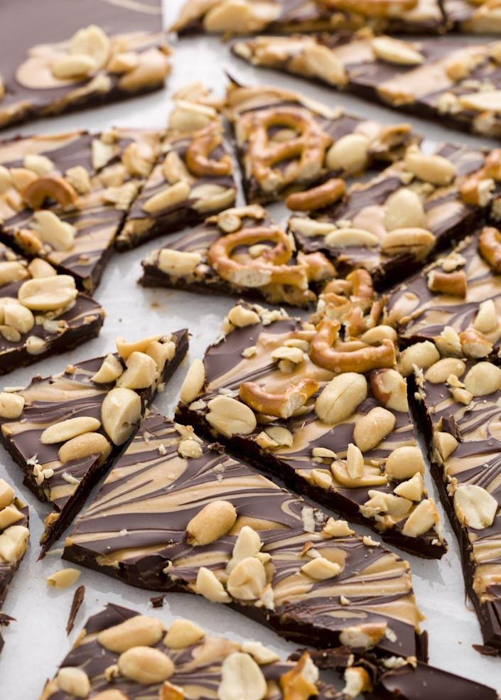 """<p>With a peanut butter drizzle, this satisfying dark chocolate bark is the perfect thing to reach for when you need something sweet.</p><p>Get the recipe from <a href=""""https://www.delish.com/cooking/recipe-ideas/recipes/a45361/skinny-chocolate-bark-recipe/"""" rel=""""nofollow noopener"""" target=""""_blank"""" data-ylk=""""slk:Delish"""" class=""""link rapid-noclick-resp"""">Delish</a>.</p>"""