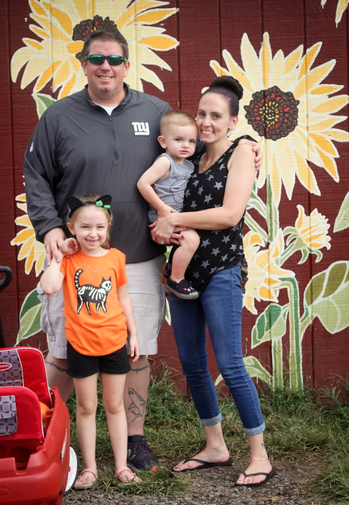 Rebecca Reilly pictured with her husband, Michael, and their children Leah and Michael. / Credit: Handout