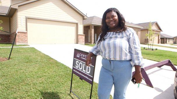 PHOTO: Iashia Nelson poses next to a 'sold' sign in front of the house she hopes to close on by the end of September 2019. (Janet Weinstein/ABC News)