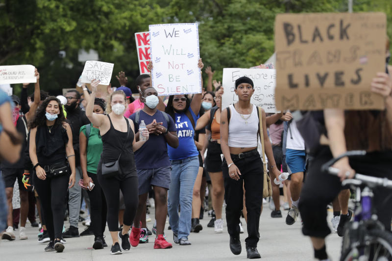 Protesters march through the streets over the death of George Floyd, Tuesday, June 2, 2020, in Miami. Protests were held throughout the country over the death of Floyd, a black man who died after being restrained by Minneapolis police officers on May 25. (AP Photo/Lynne Sladky)
