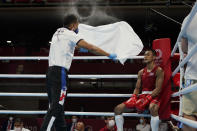 <p>Thailands Chatchai-Decha Butdee, right, gets cooled down between rounds during his mens featherweight 57-kg boxing match against Britains Peter McGrail at the Tokyo 2020 Olympics July 24, 2021 in Tokyo, Japan. (Photo by Frank Franklin II - Pool/Getty Images)</p>