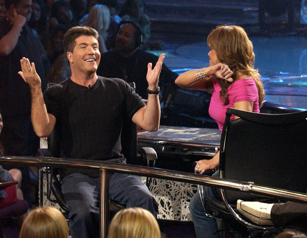 "The year 2004 starts with the airing of an <a href=""http://www.biography.com/articles/Simon-Cowell-10073482"" rel=""nofollow"">A&E Biography special</a> on Simon. Already, seismic changes are rippling among the judicial panel, with Paula Abdul's sick-outs from a persistent <a href=""http://www.people.com/people/article/0,26334,1077738,00.html"" rel=""nofollow"">nail infection</a> and Randy Jackson's 100-pound weight loss due to <a href=""http://www.people.com/people/archive/article/0,,20149169,00.html"" rel=""nofollow"">gastric bypass surgery</a>. Simon sticks to cutting remarks and black tees. He wears his signature top in a <a href=""http://www.youtube.com/watch?v=q796rUjVUeg"" rel=""nofollow"">cameo</a> appearance on ""Scary Movie 3."" The gig <a href=""http://www.new-magazine.co.uk/posts/view/15957/Simon-Cowell-s-acting-disappointment/"" rel=""nofollow"">scares him away from acting</a>. After the whopper third season of ""<a href=""/american-idol/show/34934"">Idol</a>,"" he flies back to Britain to judge ""The X Factor."" But not all goes smoothly for Mr. Nasty: Reports of his <a href=""http://www.people.co.uk/content_objectid=14049999_method=full_siteid=55768_headline=-COWELL---THE--10M-DIAMONDS-DIVORCEE-name_page.html"" rel=""nofollow"">gal pal's temper tantrums</a> and a <a href=""http://www.nypost.com/p/entertainment/tv/calls_cowell_new_show_mud_who_nasty_wzxYl1Vvtf7qyeLf2RAVhJ"" rel=""nofollow"">lawsuit</a> from collaborator Simon Fuller prove he's not the only one dishing it out."