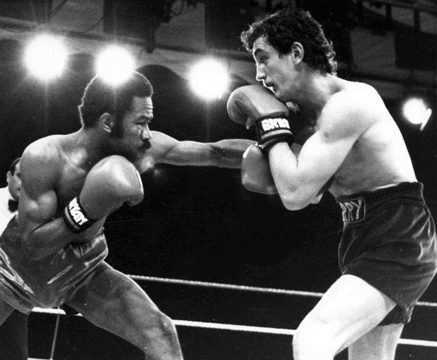FILE - In this June 9, 1985 file photo, defending champion Eusebio Pedroza from Panama, left, throws a punch at Northern Ireland's Barry McGuigan, during their World Featherweight Championship fight at Queen's Park Rangers Football Ground, London. The Panamanian ex-featherweight champ died on Friday, March 1, 2019. He was 62. (AP Photo/Bob Dear, File)