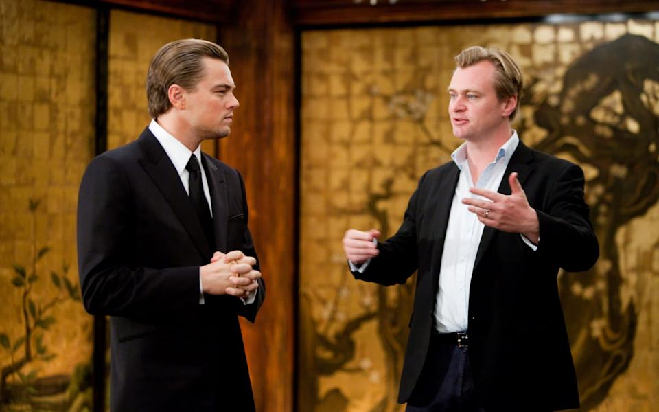 Leonardo DiCaprio and Christopher Nolan on the set of Inception -  Melissa Moseley SMPSP