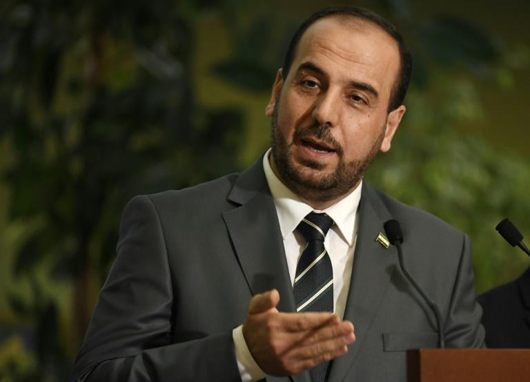 Syria's main opposition High Negotiations Committee (HNC) leader Nasr al-Hariri gives a press conference during Intra-Syrian peace talks at the European headquarters of the United Nations in Geneva, on March 2, 2017