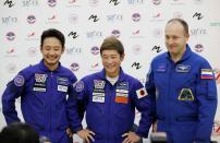 Cosmonaut Alexander Misurkin and space flight participants Yusaku Maezawa and Yozo Hirano attend a news conference ahead of the expedition to the ISS, in Star City