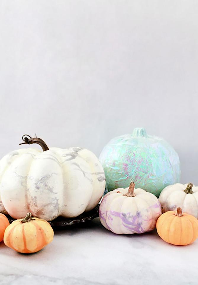 """<p>If you can't get enough of the recent unicorn trend of pretty pastel and iridescent colors, dress up your pumpkins with your favorite vibe.<br></p><p><strong>Get the tutorial at <a rel=""""nofollow"""" href=""""https://ohsobeautifulpaper.com/2016/10/diy-iridescent-pumpkins/"""">Oh So Beautiful</a>.</strong> </p>"""