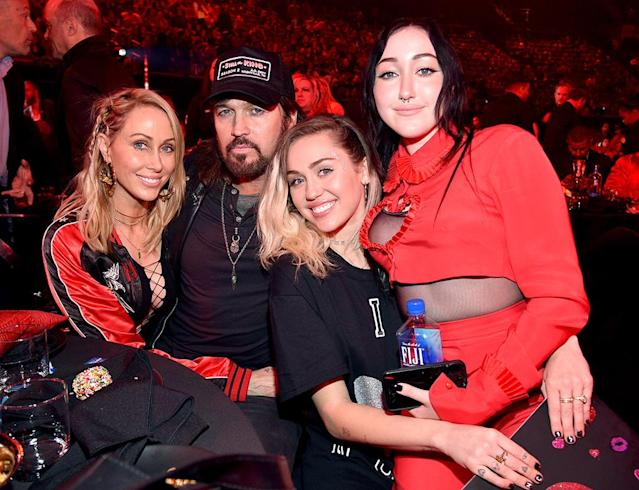 "<p>In March, Miley was playing the role of supportive sister when Noah took to the stage for her debut performance at the iHeartRadio Music Awards. Not only did the future Mrs. Liam Hemsworth introduce her sis, but she held up an ""I love Noah Cyrus"" sign in the audience. They also posed, along with mom and dad, for photographers. (Photo: Kevin Mazur/Getty Images for iHeartMedia) </p>"