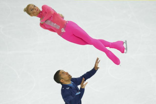 Germany's Aliona Savchenko and Robin Szolkowy compete during the Figure Skating Pairs Short Program at the Sochi 2014 Winter Olympics, February 11, 2014. REUTERS/Brian Snyder (RUSSIA - Tags: OLYMPICS SPORT FIGURE SKATING)